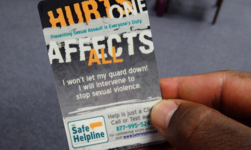 A card given out at a sexual assault awareness session in Virginia Beach, Va., in April 2013 has a phone number assault victims can call for help. SUSAN D. HENSON/U.S. NAVY