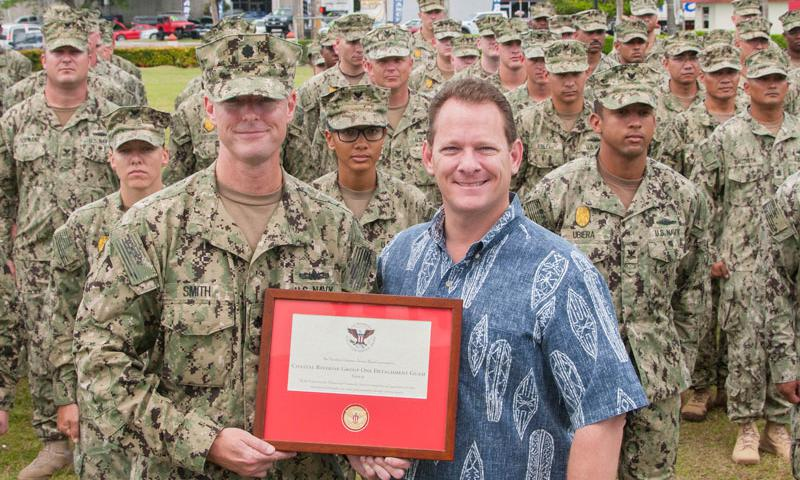 HAGATNA, Guam (May 7, 2015) – Guam Lt. Gov. Ray Tenorio presents the President's Volunteer Service Award to Cmdr. Robert Smith, officer-in-charge, Coastal Riverine Group (CRG) 1 Det. Guam during a ceremony at the Ricardo J. Bordallo Governor's Complex in Hagatna May 7. CRG-1 Det. Guam was awarded the President's Volunteer Service Award gold level for completing more than 2,000 hours of community service from March 2014 to March 2015. (U.S. Navy photo by Leah Eclavea)