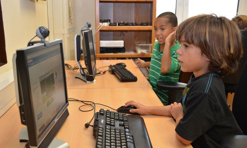 Children at the Wetzel Child Development Center spend some time at the center's computer lab. (U.S. Army photo by Ignacio Iggy Rubalcava)