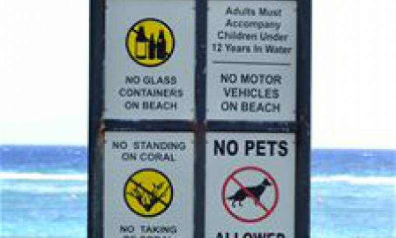 Signs are located at the entrance of Tarague Beach stating specific rules regarding the use of the beach. The rules are in place in order to promote safety and protect the environment. (U.S. Air Force photo by Staf Sgt. Alexandre Montes)