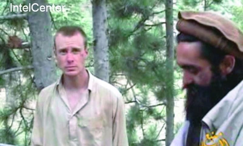 This picture shows a frame grab from a video released by the Taliban containing footage of a man believed to be Bowe Bergdahl, left. Captured in 2009, Bergdahl was released by the Taliban in May 2014.  AP