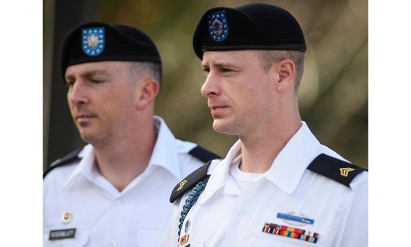In a July 7, 2016 file photo, Sgt. Bowe Bergdahl, right, arrives with his military lawyer, Lt. Col. Franklin Rosenblatt, for a legal hearing at the courtroom facility, on Fort Bragg, N.C. ANDREW CRAFT/THE FAYETTEVILLE OBSERVER