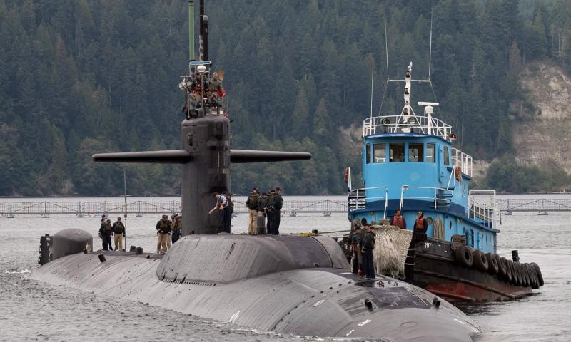 The attack submarine USS Parche returns to port for the final time at the Marginal pier at Naval Base Kitsap, Wash., in September, 2004. Brian Nokell/U.S. Navy