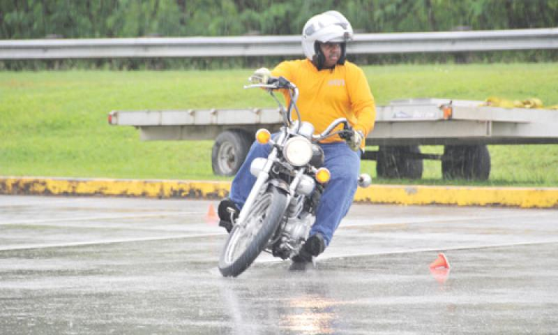 U.S. Naval Base Guam (NBG) Motorcycle Safety Program Manager Jeffrey Brown weaves through an obstacle course during a Motorcycle Safety Rodeo on NBG Oct. 13. The rodeo promoted safety and learning for motorcyclists riders and enthusiasts. U.S. Navy photo by Shaina Marie Santos