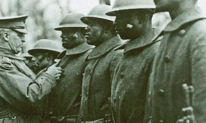 Maj. Gen. Eli A. Helmick decorates men with Distinguished Service Cross medals for exceptional bravery in France on Jan. 27, 1919. U.S. Army photo