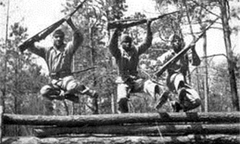 African-American recruits maneuver through an obstacle course during Marine Corps recruit training in the mid-1940s aboard Montford Point now Marine Corps Base Camp Johnson, N.C. The Montford Point Marines were the first African Americans in the Marine Corps and helped pave the way for the Marine Corps to become the racially non-biased fighting force it is today. Photo by Courtesy Asset
