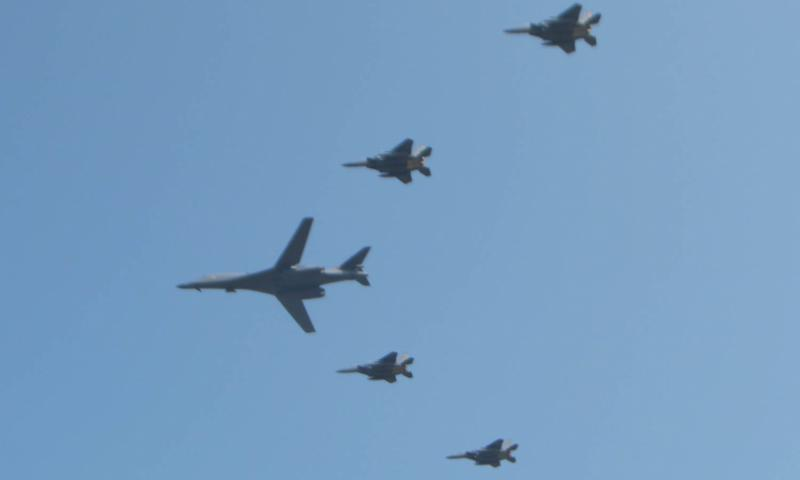 A nuclear-capable B-1B Lancer bomber, flanked by four fighter jets, flies over Osan Air Base, South Korea, Tuesday, Sept. 13, 2016. The show of force came four days after North Korea conducted its fifth and most powerful nuclear test. Kim Gamel/Stars and Stripes