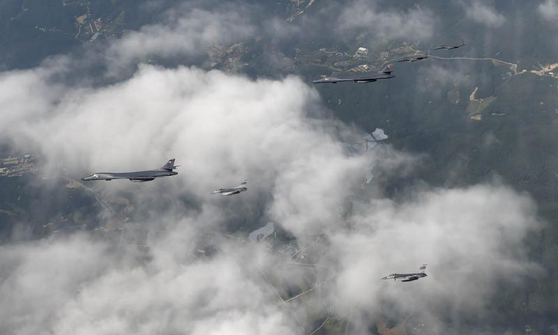 A formation of two B-1B Lancers deployed to Andersen Air Force Base, Guam, and four F-15K Slam Eagles assigned to Daegu Air Base, South Korea, fly over South Korea, Wednesday, Sept. 21, 2016. Kim Kyeong-ryul/Republic of Korea