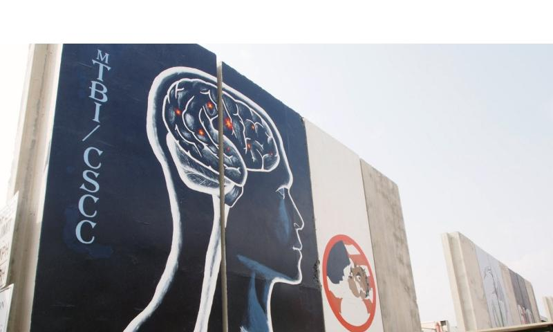 A mural on a concrete blast wall for the Concussion Specialty Care Center at Bagram Air Field, in Afghanistan, where many troops who have suffered a traumatic brain injury are sent to recover. Medical professionals at the center say new sensor technology is helping them better treat patients with head injuries.   Heath Druzin/Stars and Stripes