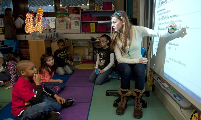 Lexi Vermeire spends time volunteering to teach and mentor second grade students of Ramstein Air Force Base elementary school before her own classes start in high school on Jan. 28, 2013    Bennie J. Davis III/U.S. Air Force