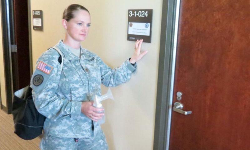 Maj. Christine Orser, a Reserve component career manager with U.S. Army Human Resources Command's Officer Personnel Management Directorate, enters HR's designated Mother's Wellness Room on Nov. 23, 2015. As a breast-feeding mother, Orser uses the room daily during duty hours to express milk.    Michele White/U.S. Army