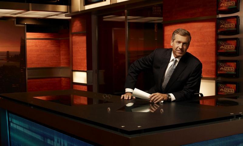 "Brian Williams, anchor of ""Nightly News"" and managing editor at NBC News, sits at his desk.  Justin Stephens/NBC"
