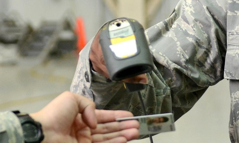 Scanning a common access card.   U.S. Air Force