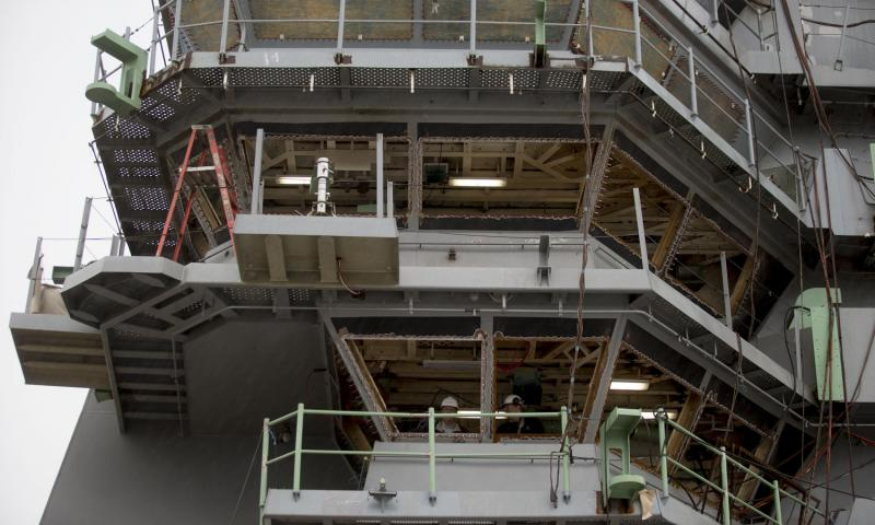 A 2014 photo shows men standing inside the island tower aboard the USS Gerald R. Ford (CVN 78) aircraft carrier during outfitting and testing at Huntington Ingalls Industries' Newport News Shipbuilding shipyard in Newport News, Virginia.  Andrew Harrer/Bloomberg