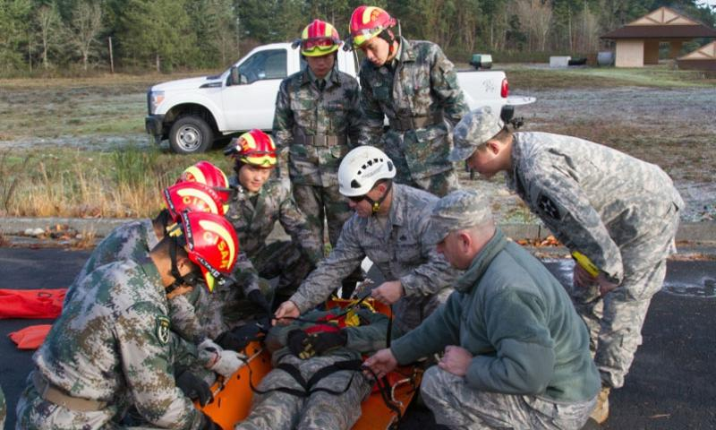 Troops from the U. S. Army and Air Force demonstrate ways to secure and evacuate casualties to their People's Republic of China People's Liberation Army counterparts during the Disaster Management Exchange held at Joint Base Lewis McChord, Wash., Nov. 20, 2015.    Trish McMurphy/ U.S. Army photo