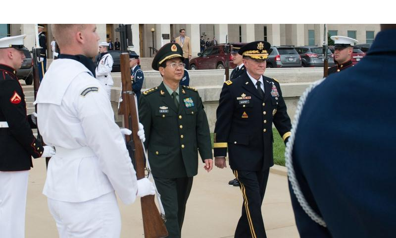 Gen. Martin E. Dempsey, chairman of the Joint Chiefs of Staff, and Chinese Gen. Fang Fenghui, chief of the General Staff of the People's Liberation Army, walk together during a full-honor welcome ceremony at the Pentagon on May 15, 2014. Gen. Dempsey hosted the ceremony, which was the first full-honor ceremony conducted since 2012. (D. MYLES CULLEN/COURTESY OF THE DOD)