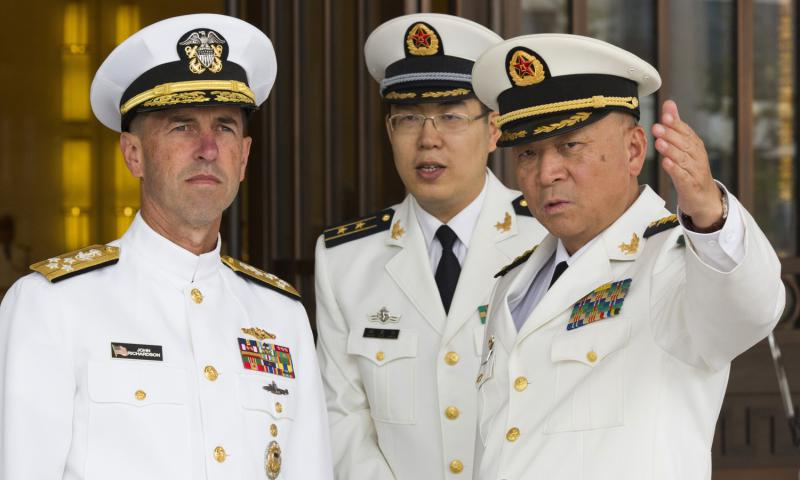 U.S. Chief of Naval Operations Adm. John Richardson listens to Commander of the Chinese Navy Adm. Wu Shengli, right, at the Chinese navy's headquarters in Beijing on Monday, July 18, 2016. Richardson said friendly exchanges with China's navy are conditional on safe and professional interactions at sea. His comments, made Wednesday, July 20, 2016, follow several fractious encounters between the two sides' ships and planes in and over the disputed South China Sea. 	 Ng Han Guan, Pool/AP