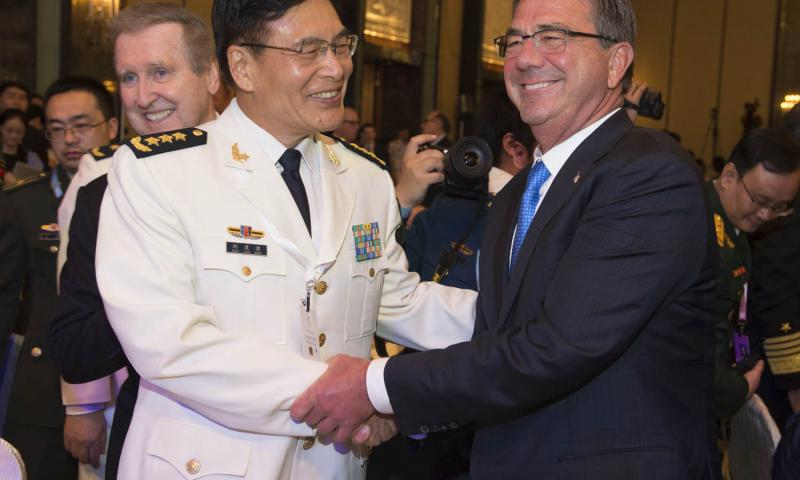 Secretary of Defense Ash Carter greets Chinese Adm. Sun Jianguo in Singapore, in June 2016. The senior Chinese admiral rejected freedom of navigation for military ships at a recent forum, despite views held by the United States and most other nations that such freedom is codified by international law. 	 Tim Godbee/Defense Department