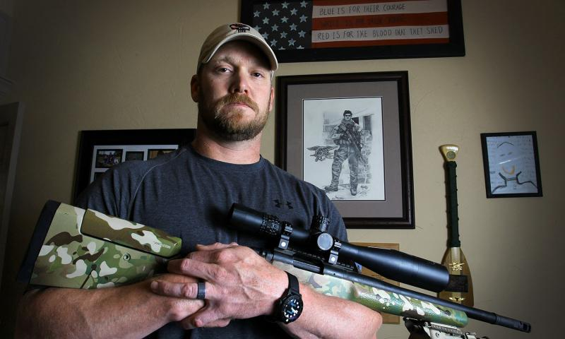 """American Sniper"" Chris Kyle holds a .308 sniper rifle in this April 6, 2012, file photo. 	 Paul Moseley, Fort Worth Star-Telegram/MCT"