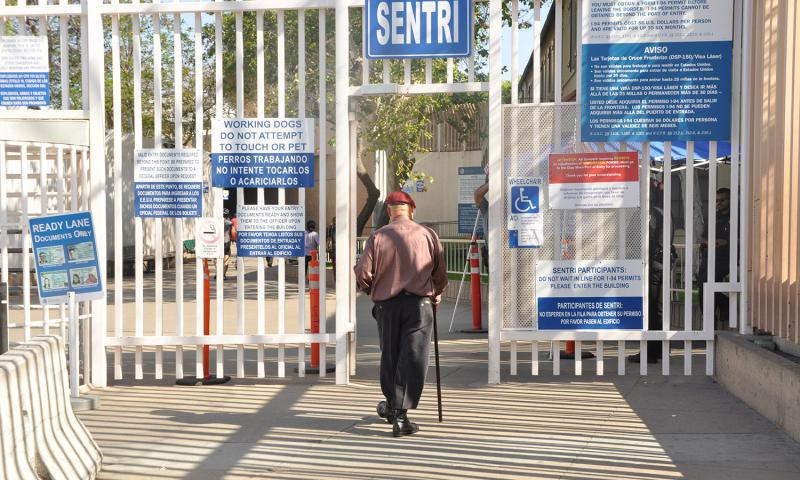 Hector Barajas, founder of the Deported Veterans Support House in Tijuana, Mexico, walks through the gates at the Mexico-U.S. border on June 2, 2016, where he was meeting U.S. immigration officials for fingerprinting. Barajas, a deported veteran, is being considered for citizenship. 	 Dianna Cahn/Stars and Stripes