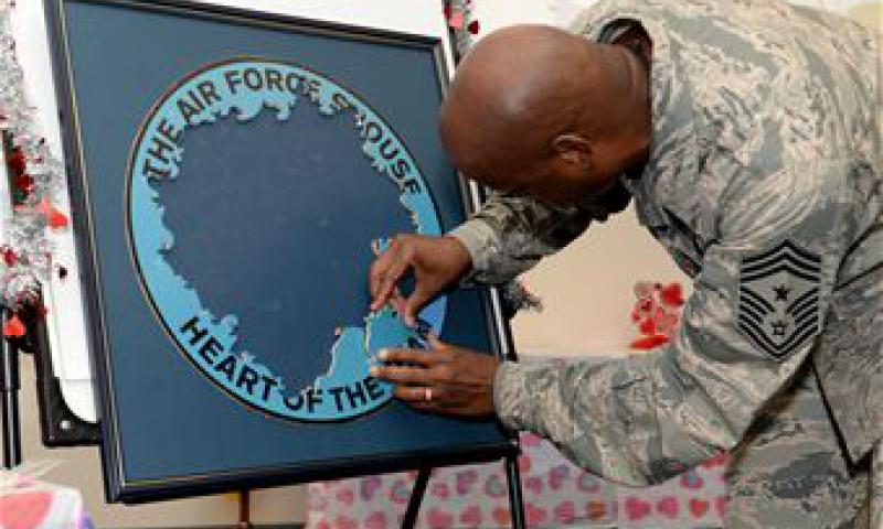 Chief Master Sgt. Michael McMillan, 36th Wing command chief master sergeant, attaches a puzzle piece during the Heart Link Spouses Workshop Jan. 26.