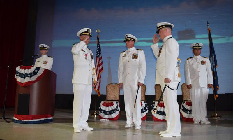 Cmdr. Brian T. Turney, center right, relieves Cmdr. Lance E. Thompson, center left,  of command of the Los Angeles-class attack submarine USS Chicago (SSN 721) during a change-of-command ceremony at Naval Base Guam May 12, 2016.  U.S. Navy photograph by Mass Communication Specialist Seaman Daniel S. Willoughby
