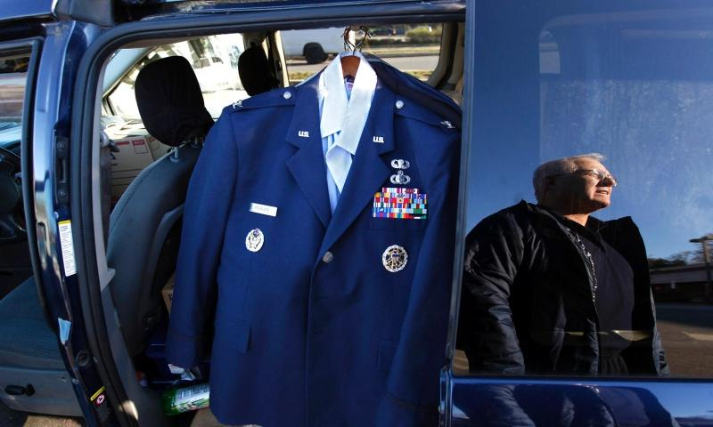 Retired Air Force Col. Bob Freniere carries his uniform in his van, where he is now living, Nov. 19, 2013, in King of Prussia, Pa.   Michael Bryant/Philadelphia Inquirer