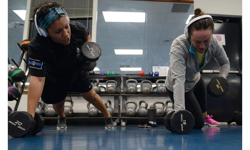 Staff Sgt. Tasha Coolidge, left, 36th Security Forces unit training manager, and her wife, Staff Sgt. Chelsey Coolidge, 736th SFS commando warrior instructor, work out together June 16, 2016, at Andersen Air Force Base, Guam. Both Airmen have demanding jobs as members of security forces units at Andersen AFB, which requires them to be physically fit to support missions at a moment's notice.
