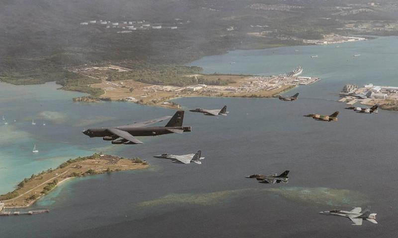 U.S. Air Force, Japan Air Self-Defense Force and Royal Australian Air Force aircraft fly in formation during a Cope North exercise, Feb. 17, 2015, off the coast of Guam. The Philippines will take part in this year's training, which will begin with a two-day, table-top humanitarian and disaster-relief exercise. Focus will then shift to fighter-versus-fighter air combat tactics, air-to-ground strike missions and large-force employment training.     Jason Robertson/U.S. Air Force photo