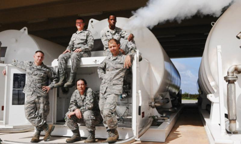 Airmen from the 36th Logistics Readiness Squadron's fuels management cryogenics production element pose in front of a liquid oxygen storage tank at Andersen Air Force Base Nov. 29. Unique to a few locations in the Air Force, the team utilizes cryogenic technology to provide pure, clean breathing oxygen and clean, dry nitrogen in support of a multitude of units' aviation, medical and maintenance needs. U.S. Air Force photo by Senior Airman Carlin Leslie