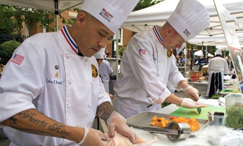 Two military chefs prepare their meal during the 2015 Military Culinary Competition, that took place in front of the Marine Barracks in Washington, D.C., on Sept. 26, 2015.   Meredith Tibbetts/Stars and Stripes