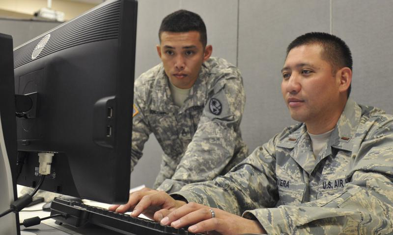 U.S. Army National Guard Staff Sgt. Vincent Iglesias of the 1/294th Infantry Battalion, and 2nd Lt. Tommy Rivera of the 254th Air Base Group, verified the login accounts of their fellow Blue Team 6 members, all from Guam, for a miniature exercise during Cyber Shield 2016 at Camp Atterbury, Ind., April 22, 2016. Stephanie A. Hargett/U.S. Army