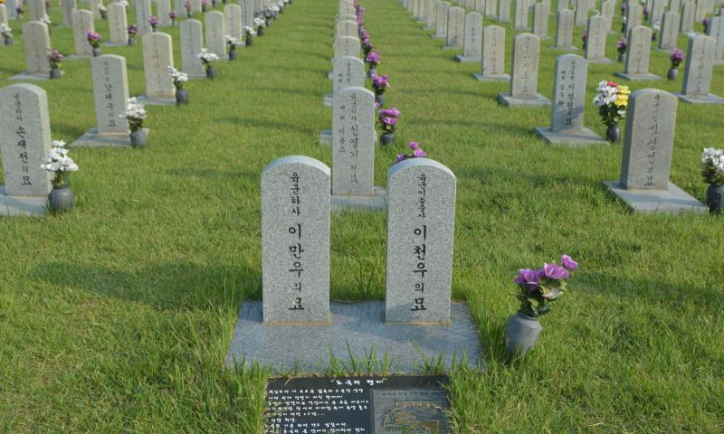 The graves of two South Korean brothers who died while fighting in the Korean War. One was buried in the National Cemetery in Seoul after he died in 1951, while the other was interred in 2010 after his remains were found as part of the military's search efforts. Kim Gamel/Stars and Stripes