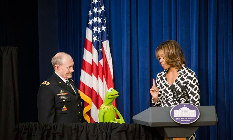 "Army Gen. Martin E. Dempsey, chairman of the Joint Chiefs of Staff, joins First Lady Michelle Obama and Kermit the Frog in welcoming military families to a screening of the new movie ""Muppets Most Wanted"" at the White House, March 12, 2014. The trio thanked military families for their service, strength and resilience.  DOD photo by Army Staff Sgt. Sean K. Harp"