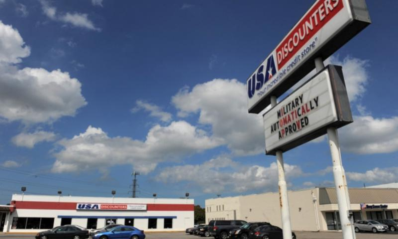 A location of USA Discounters is seen on June 24 in Norfolk, Va. MATT MCCLAIN/THE WASHINGTON POST