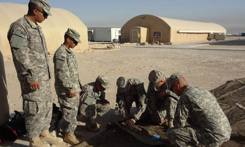 Soldiers assigned to B Company, 2nd Battalion, 34th Armor Regiment prepare to install a Solar Shade System to cover a 100-foot tent July 9, 2014, in an effort to reduce the fuel and energy used to cool the shelter. Surveys suggest that as many as 80% of those who serve come from a family in which a parent or sibling is also in the military.   Sgt. Woodbridge Dean Bullock/U.S. Army