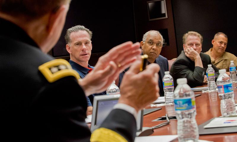 Jamie Dixon, University of Pittsburgh men's basketball head coach, Tubby Smith, Texas Tech University men's basketball head coach, and Tom Izzo, Michigan State University men's basketball head coach, listen as Army Gen. Martin E. Dempsey, chairman of the Joint Chiefs of Staff, talks with participants of a sports leadership seminar at the Pentagon, May, 7 2014. DOD photo by Army Staff Sgt. Sean K. Harp