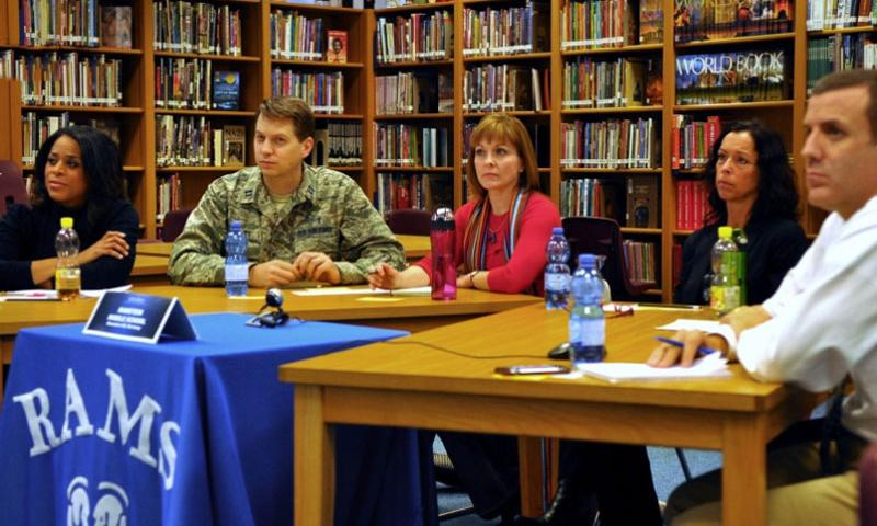 A group from Ramstein Middle School listens in on the live video discussion with Department of Defense Education Activity leaders and five other schools from across DODEA on Tuesday, Oct. 20, 2015. They are, from l-r, Sequinn Lee, RMS 6th grade language arts teacher; parents Air Force Capt. Matthew Streett, Jenny Cline and Suzanne Villella; and RMS Principal Josh Adams. Jennifer H. Svan/Stars and Stripes  Jennifer H. Svan/Stars and Stripes