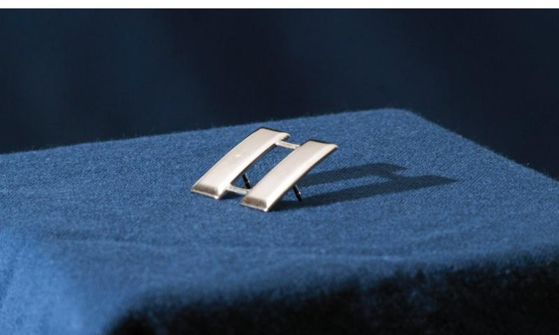 The rank of captain has been symbolized by double silver bars since 1832, and is sometimes referred to as railroad tracks.   Robert Barnett/U.S. Air Force