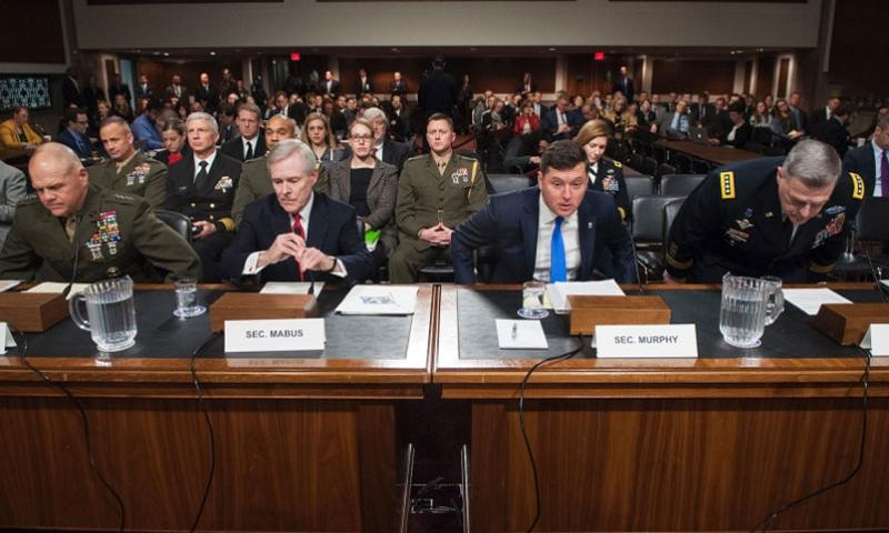 Taking their seats at the start of a Senate Armed Services Committee hearing on Tuesday, Feb. 2, 2016, on Capitol Hill in Washington are from left: Marine Corps Commandant Gen. Robert Neller, Secretary of the Navy Ray Mabus, Acting Secretary of the Army Patrick Murphy and Army Chief of Staff Gen. Mark Milley.      Carlos Bongioanni/Stars and Stripes