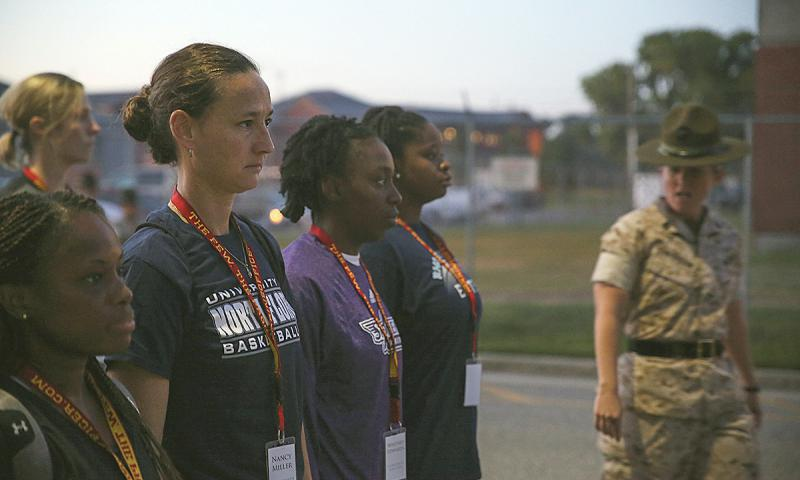 A Marine drill sergeant inspects a group of college women basketball coaches taking part in a leadership workshop at Parris Island, S.C., on Aug. 27, 2014. The Senate Armed Services Committeee on Thursday passed a measure proposing that women be required by 2018 to sign up for Selective Service, which would make them eligible to be drafted for military service in the event the draft were reenacted.  John-Paul Imbody/U.S. Marine Corps