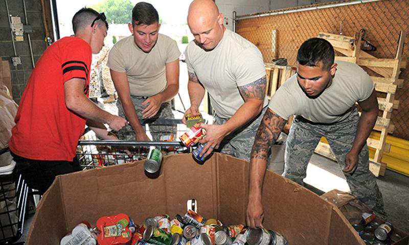 Air Force members load a pallet with donated food at the Your Connection Center at Hill Air Force Base in Layton, Utah, for the Feds Feed Families food drive. U.S. Air Force Photo by Todd Cromar