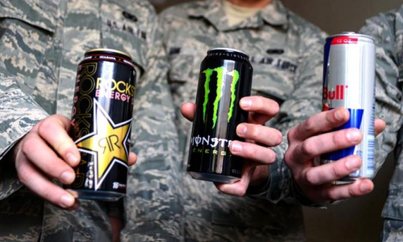 From left, Senior Airman Kenneth Havro, Airman 1st Class Anthony Soik and Senior Airman Jordan Belloff, members of the 86th Security Forces Squadron at Ramstein Air Base, Germany, pose with their energy drinks of choice. Joshua L. DeMotts/Stars and Stripes
