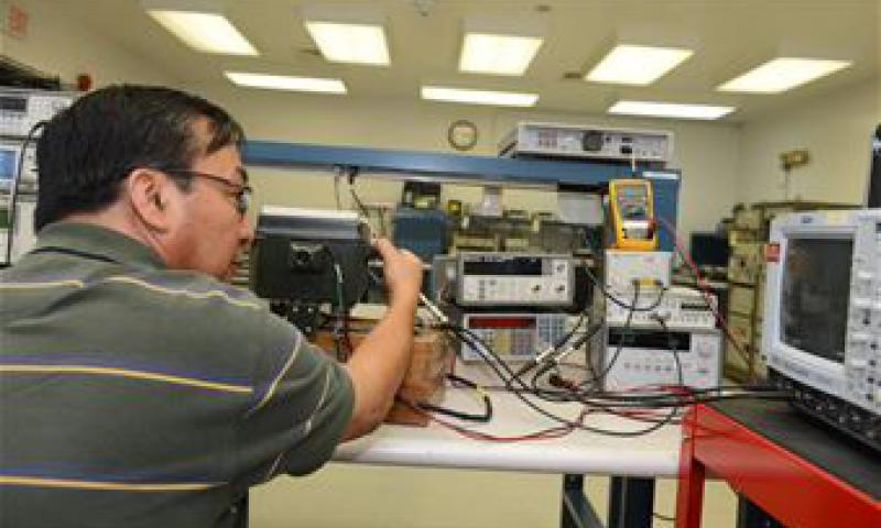 Oscar Cabatic, 36th Maintenance Squadron Precision Measurement Equipment Laboratory technician, analyzes a signal using a transponder test set, a spectrum analyzer, and a peak power meter June 19, 2015, at Andersen Air Force Base, Guam. PMEL technicians ensure all the equipment they calibrate on a daily basis is accurate and reliable for the many units they support. (U.S. Air Force photo by Airman 1st Class Arielle Vasquez)