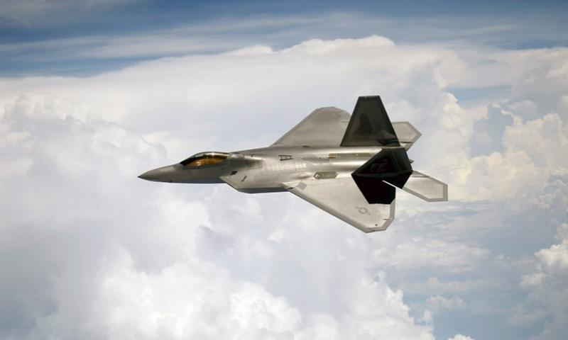 An F-22 Raptor flies a mission off the East Coast on July 10, 2012. JEREMY LOCK/U.S. AIR FORCE