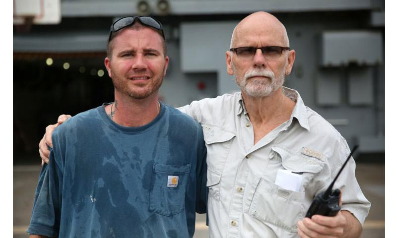 Civilian mariners Shane (left) and Ron McCann, father and son, are both assigned to fleet replenishment oiler USNS Walter S. Diehl. Shane is a boatswain mate and Ron, is the supply officer