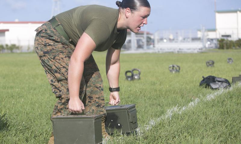 Cpl. Katheryn Jones performs an ammunition can carry while competing in a High Intensity Tactical Training competition June 17, 2016 aboard Camp Foster, Okinawa, Japan. New physical standards established so women can compete for combat posts in the Marine Corps have weeded out many of the female hopefuls. But they're also disqualifying some men, according to data obtained by The Associated Press.  Douglas Simons/U.S. Marine Corps