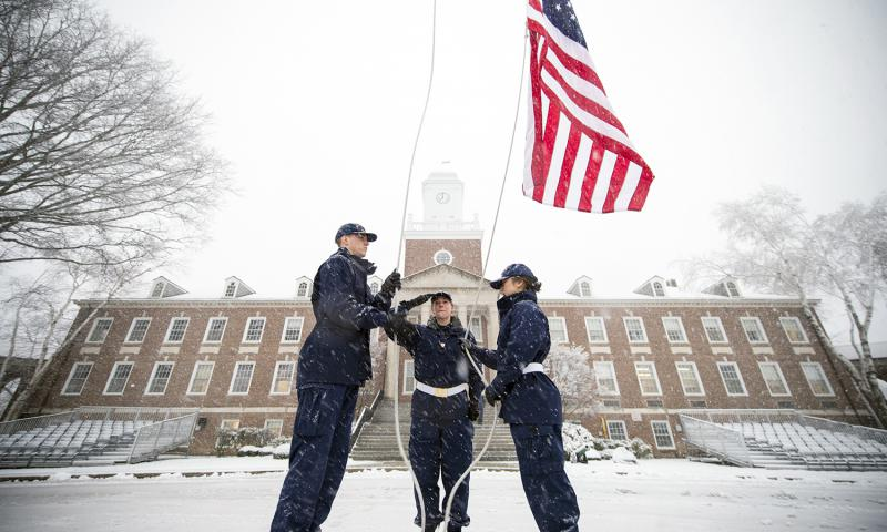 Cadets at the U.S. Coast Guard Academy conduct morning colors as snow falls on campus Feb. 5, 2016. Cory J. Mendenhall/U.S. Coast Guard Academy