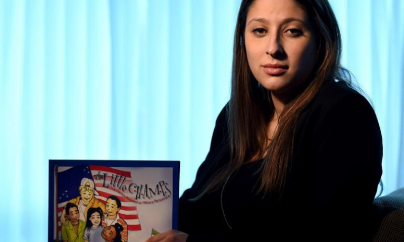 "Jennifer Fink says she didn't expect the controversy that would surround her book ""The Little C.H.A.M.P.S. -- Child Heroes Attached to Military Personnel."""