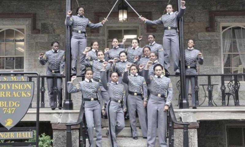 This undated image obtained from Twitter on Saturday, May 7, 2016 shows 16 black, female cadets in uniform with their fists raised while posing for a photograph at the United States Military Academy at West Point, N.Y. The U.S. Military Academy has launched an inquiry into the image that has spurred questions about whether the gesture violates military restrictions on political activity. Twitter via AP